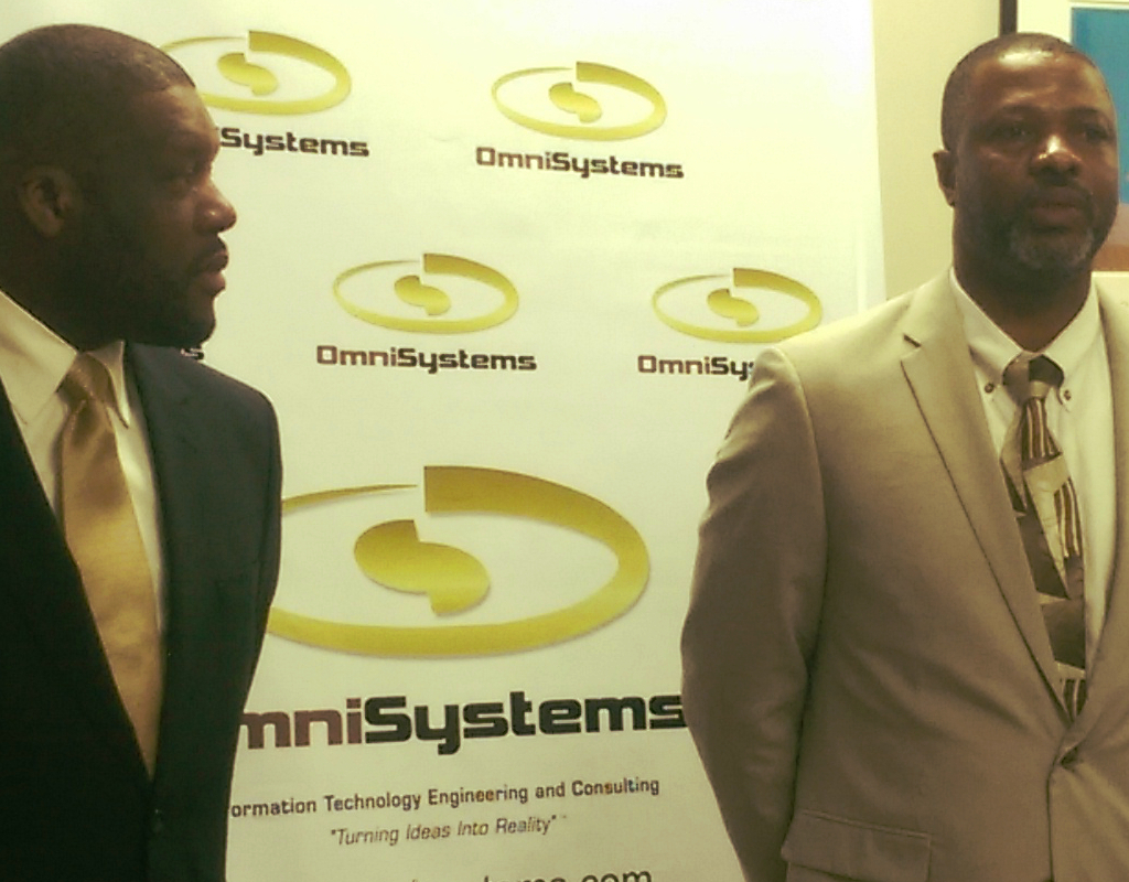 Reginald Vigilant and Ian Tomlinson of OmniSystems at their tech expo on St. Thomas